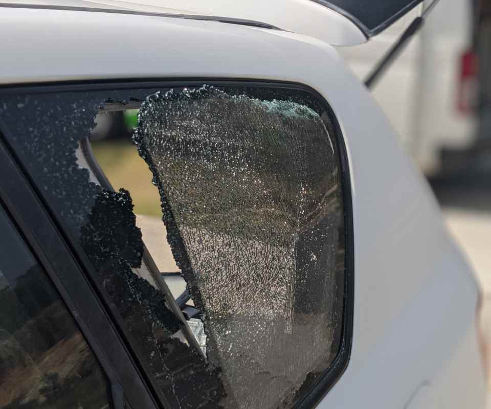 Shattered vehicle side window. Auto glass replacement