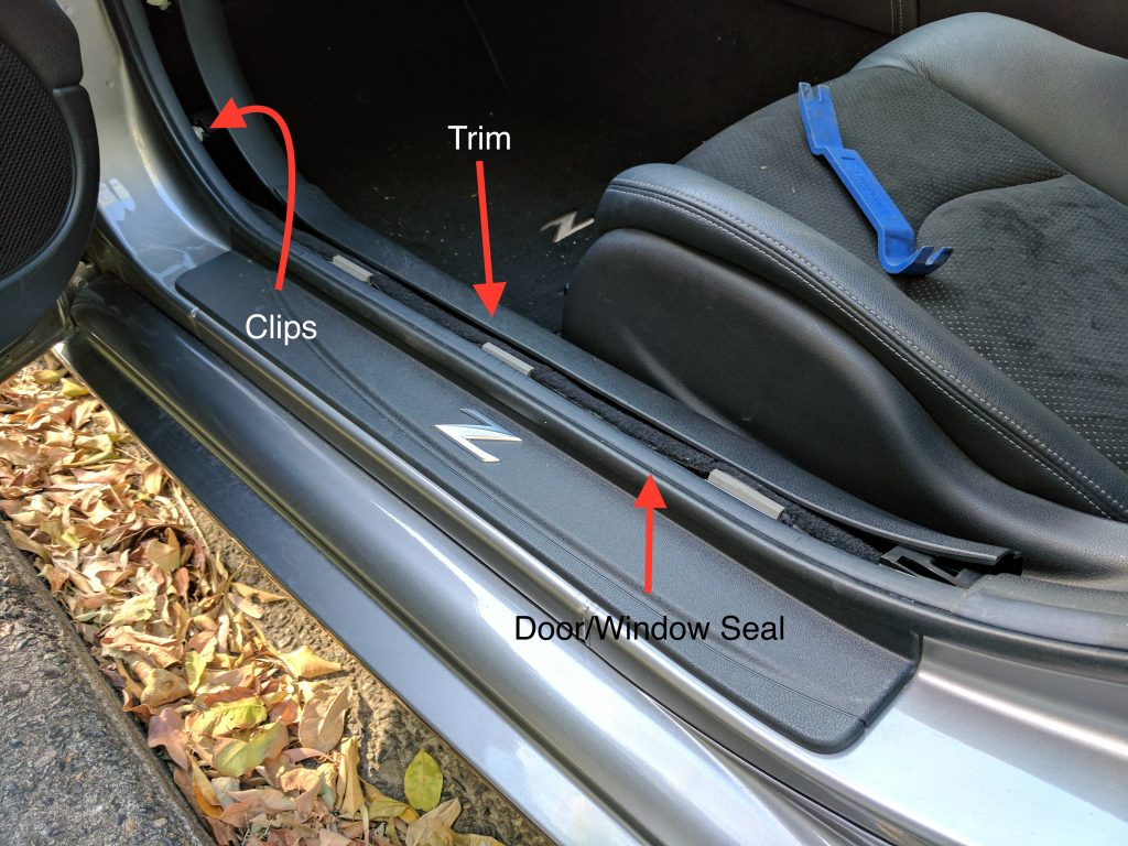 Nissan 370z door seal trim cover removed.